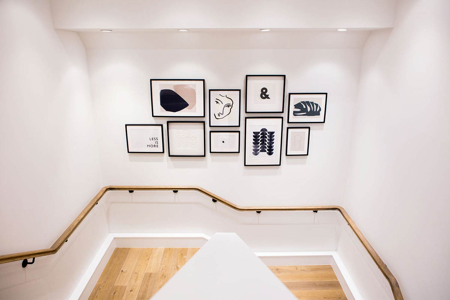 Framed images on a white wall